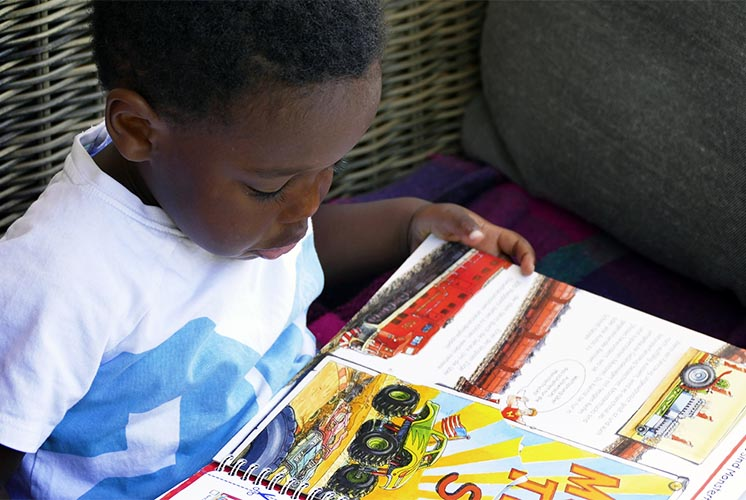 A boy reading a picture book