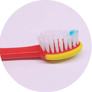 Use a smear on toothbrushes for children under age 3