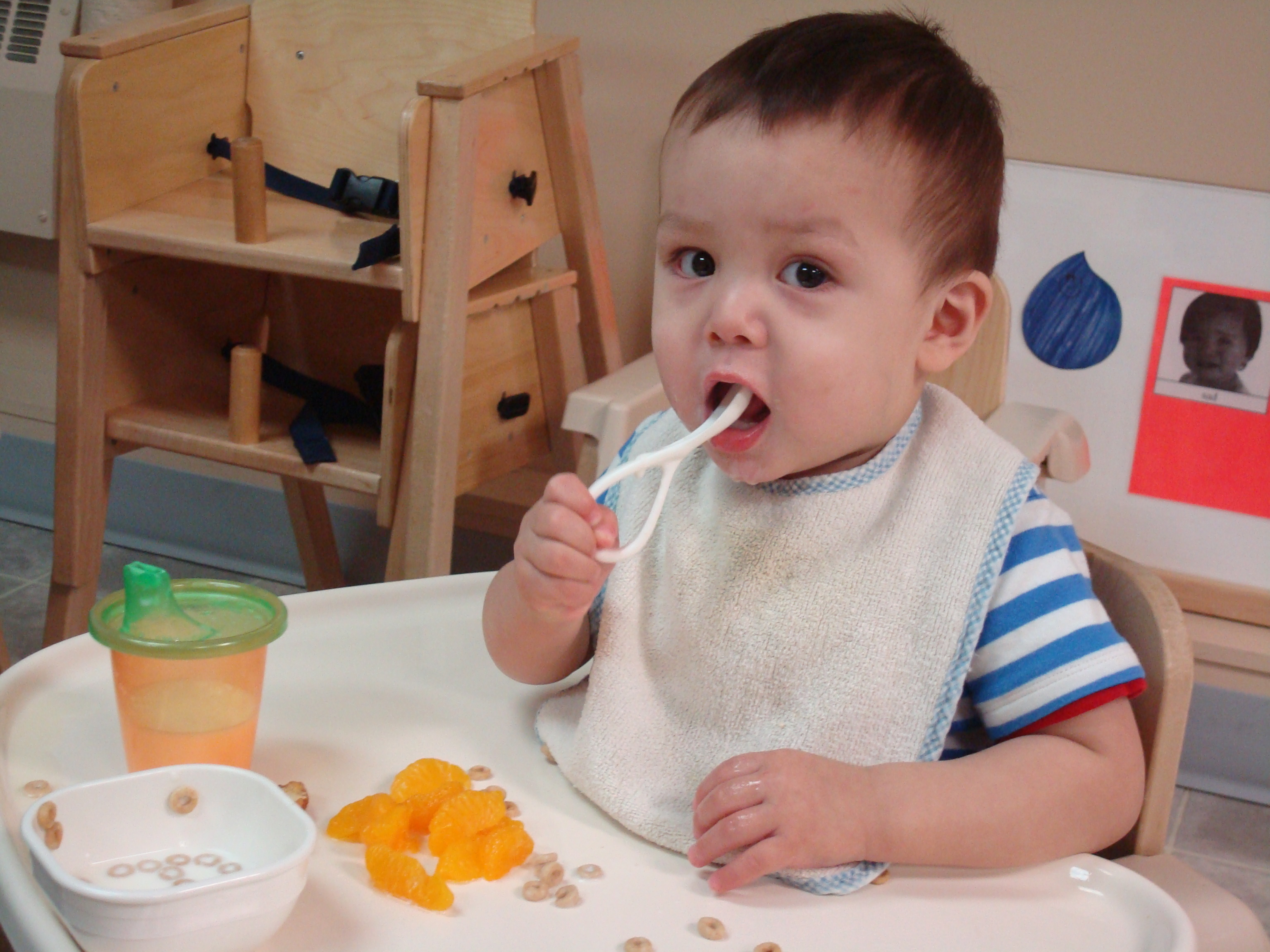 child eating in feed chair