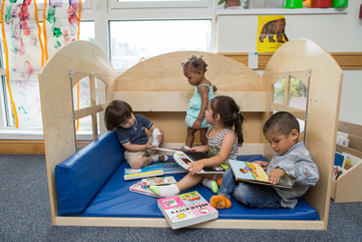 Children reading in play bed
