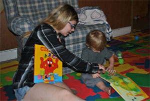 Mother reading books with child
