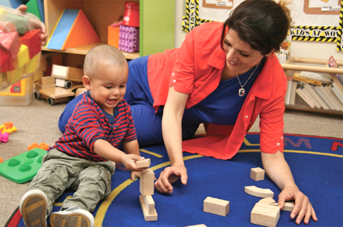 woman and child playing with blocks