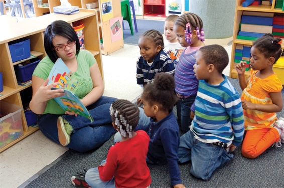 Woman reading to group of children