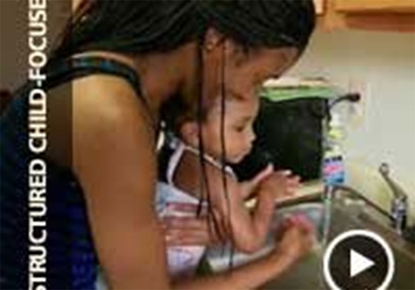 Video thumbnail of a woman washing her daughter's hands