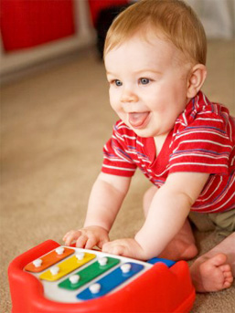 child playing with xylophone