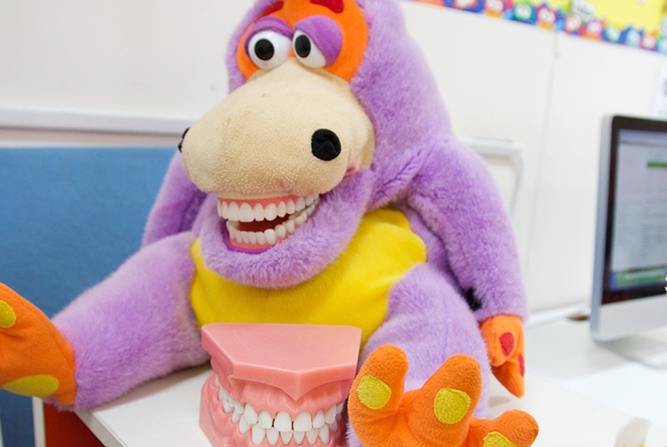 A stuffed animal and set of plastic teeth