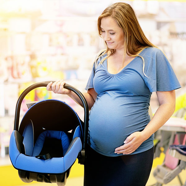 Pregnant woman shopping for car seats