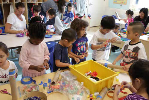 Children working on arts and crafts in a classroom