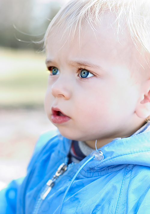 Young child in a light blue jacket