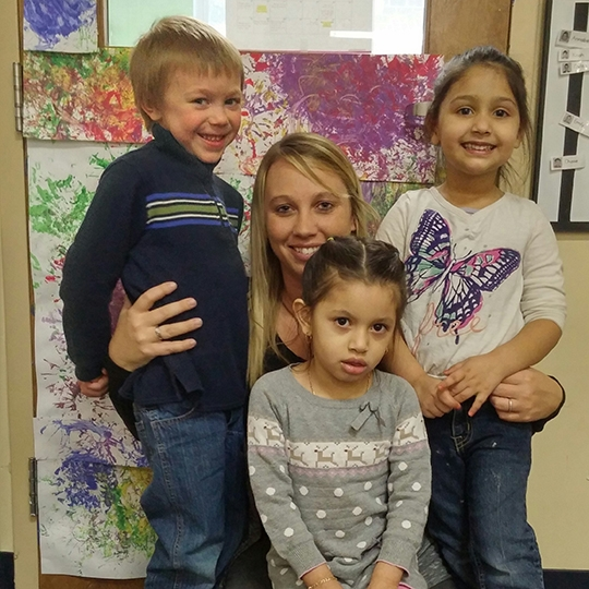 Tracey Stone with three Head Start kids